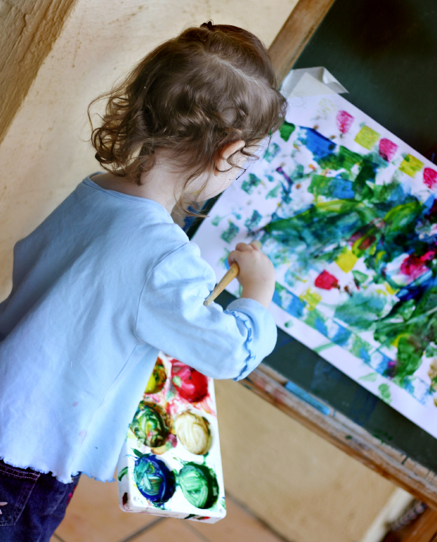 Preschool girl painting
