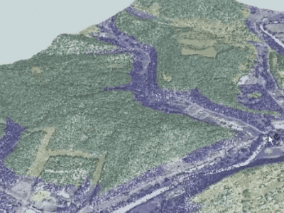 In this example point cloud, calculations were applied to every point in order to generate a visualization for flood predictions. Every point below a certain elevation is set to blue, and every point above is set to a colour from an overlaid raster